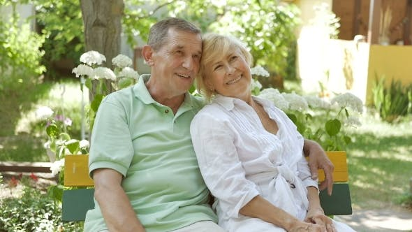 Thumbnail for Elderly Couple Sitting on a Bench in an Embrace.