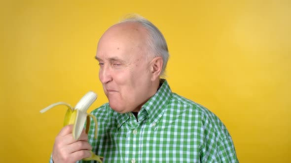 Thumbnail for Elderly Man Eating Banana