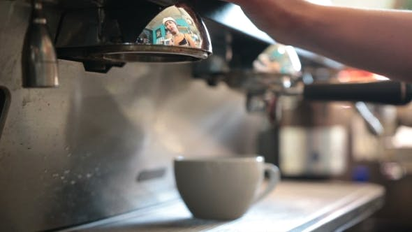 Cover Image for Young Barista Preparing Coffee In a Cafe