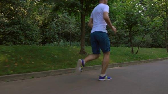 Thumbnail for Male Runner In White Tshirt Running In The Park
