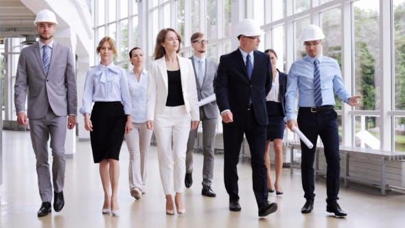 Thumbnail for Business Team In Helmets Walking Along Office 57