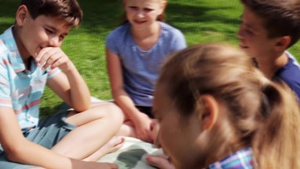 Thumbnail for Group Of Happy Kids Sitting On Grass And Talking 20