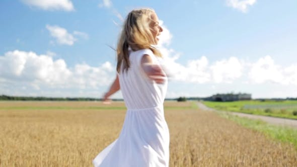 Thumbnail for Smiling Young Woman In White Dress On Cereal Field 11