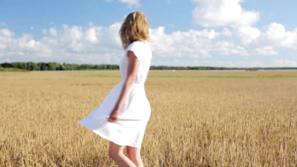 Thumbnail for Smiling Young Woman In White Dress On Cereal Field 13