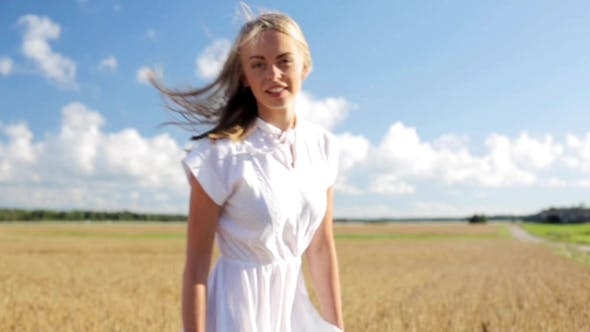 Thumbnail for Smiling Young Woman In White Dress On Cereal Field 16