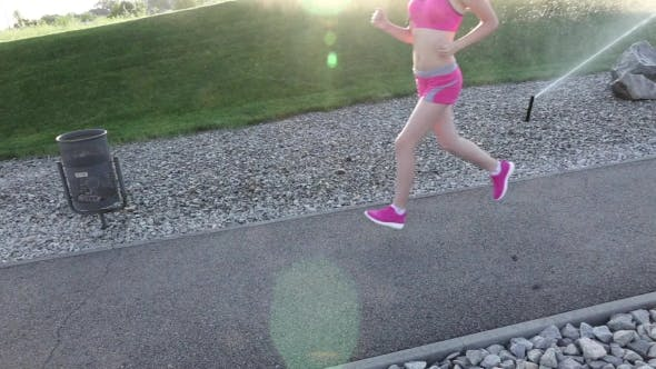 Thumbnail for Fitness Routine For Women - Athletic Girl Runner Jogging Along Road Wide Angle.