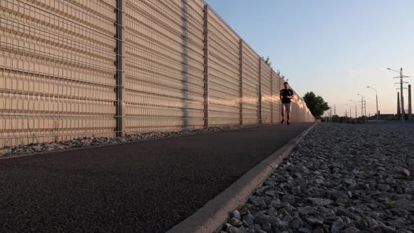 Thumbnail for Man Running On Mountain Road At Sunset