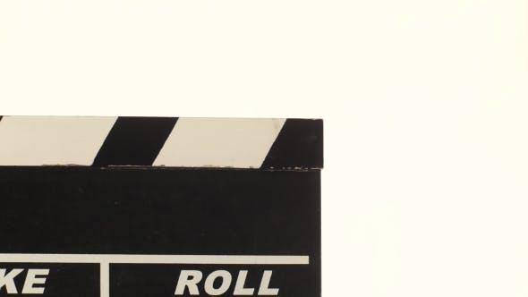 Thumbnail for Person Uses Movie Clapper Board, On White,