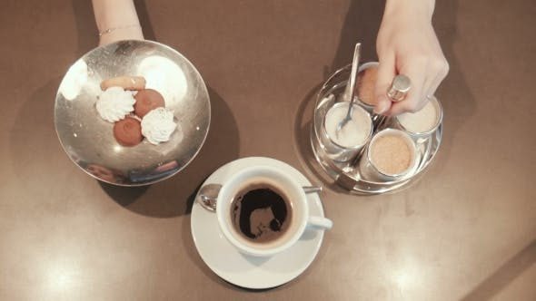 Cover Image for Waitress Placing a Coffee On The Counter top view