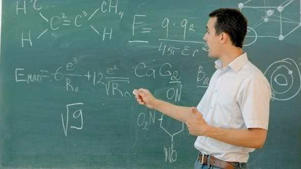 Thumbnail for Young Teacher Near Chalkboard In School Classroom