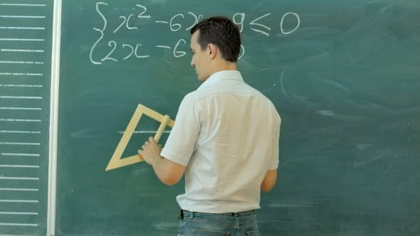 Thumbnail for Young Teacher Or Student Draw Triangle On a Blackboard With Formula