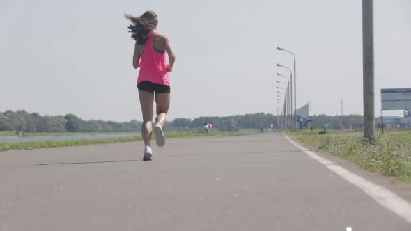 Thumbnail for Girl Runs At The Stadium On a Sunny Day