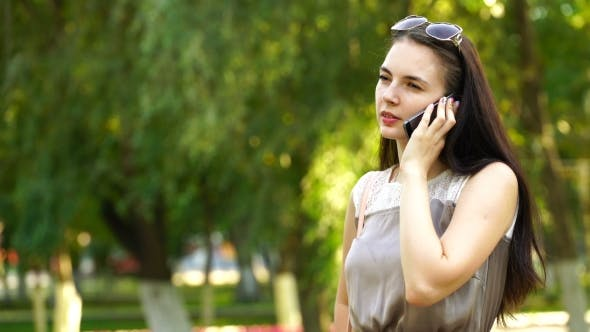 Thumbnail for Footage Young Woman Talking On The Smartphone Outdoors