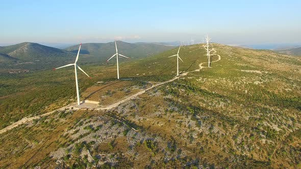 Thumbnail for Flying above elegant ecological wind turbines on green hills