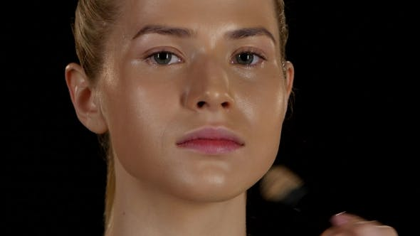 Thumbnail for Applying Foundation On The Face Of The Model. Black.