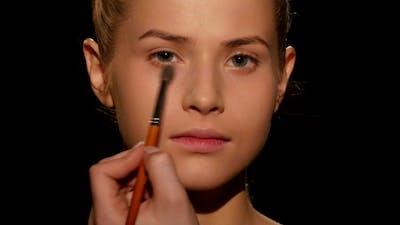 Professional Make-up Artist. Make-up Artist Doing Make-up. Black.