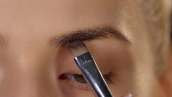 Thumbnail for Beautiful Woman Draw Beauty Shape Of Eyebrows Using Cosmetic Brush. Black.