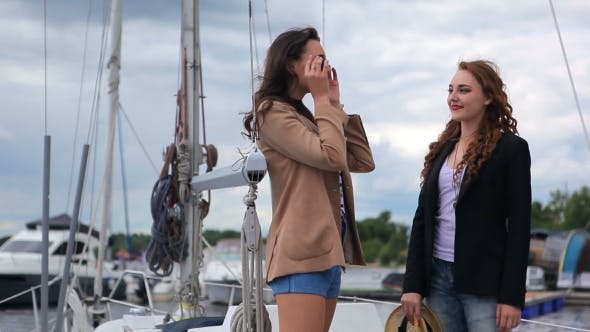 Girls Wearing Glasses And a Hat On a Yacht