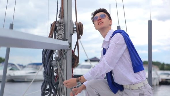 Thumbnail for Man Pulls a Rope Reels Off a Yacht