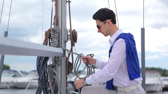 Thumbnail for Man Reeling The Rope On The Yacht