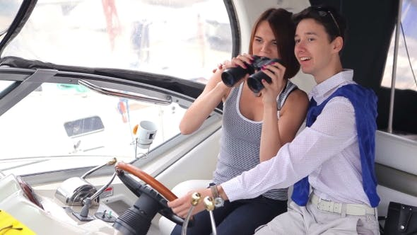 Thumbnail for Man And Girl Sitting At The Helm Of a Yacht