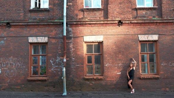 Thumbnail for Beautiful Woman Posing at the Old Brick Building