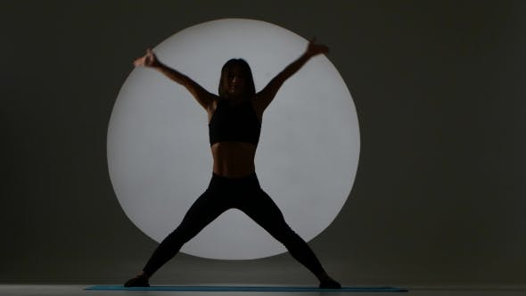 Cover Image for Athlete Does Pose Mountain. Back Light. Silhouette