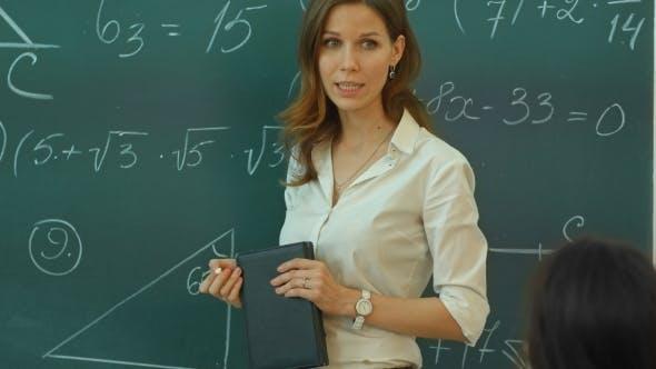 Thumbnail for Teacher Doing Math On Chalkboard