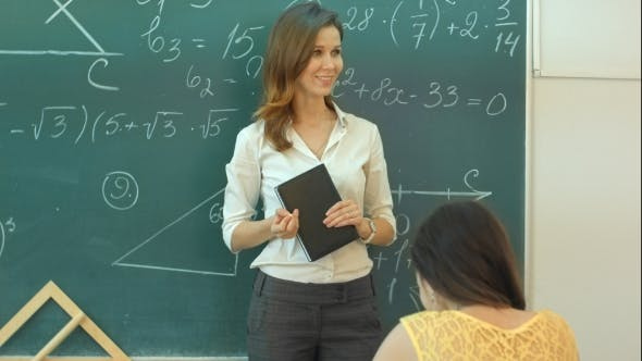 Thumbnail for Smile Teacher Talk About Mathematic Task On Green Chalkboard In Classroom