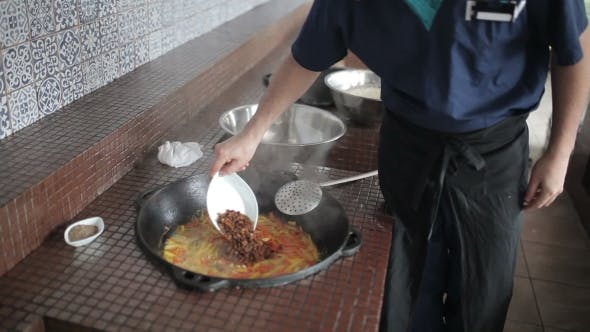 Thumbnail for Cook Adding Spices Into The Pot.