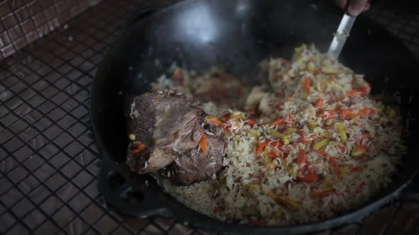Thumbnail for Rice With Vegetables And Lamb Stirred Kettle.