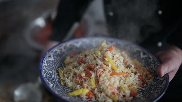 Thumbnail for Pilaf Poured a Large Spoon On a Beautiful Plate.