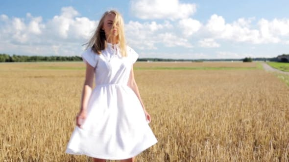 Thumbnail for Smiling Young Woman In White Dress On Cereal Field 51