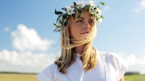 Thumbnail for Smiling Young Woman In Wreath Of Flowers Outdoors 57