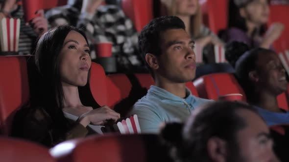 Nice Mixed Race Couple Watching Movie in Cinema