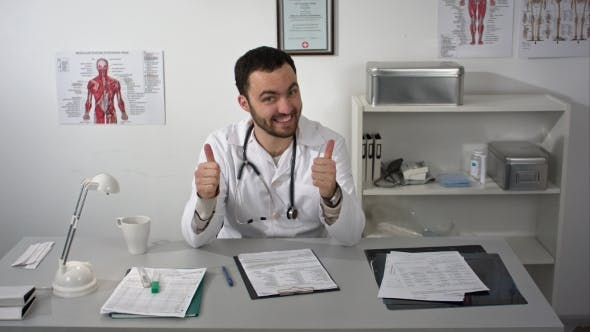 Thumbnail for Smiling Medical Doctor Showing Thumbs Up