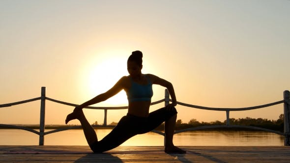Thumbnail for Woman Practicing Yoga On The Beach At Sunset. Healthy Active Lifestyle Concept