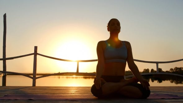 Thumbnail for Woman Meditating At Beach On Sunset