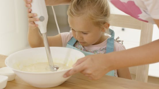 Thumbnail for Cute Little Girl Learning To Bake From Mother