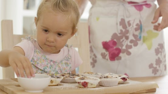 Thumbnail for On Girl Helping To Prepare Muffins
