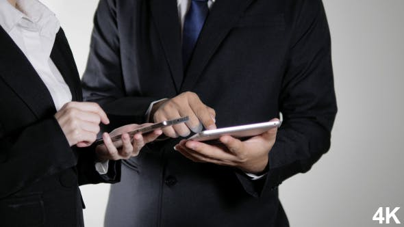 Thumbnail for Business People With Tablet And Smartphone