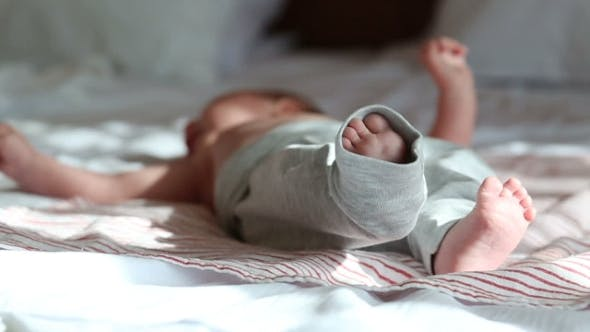 Thumbnail for Newborn Baby Lying On a Bed