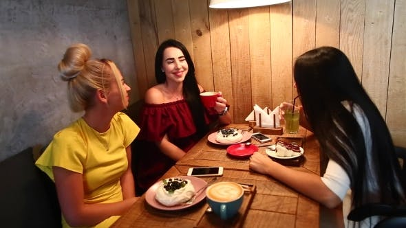 Cover Image for Three Beautiful Female Smile In Cafe, Talk, Tell Secrets, Eat, d