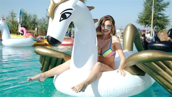 Thumbnail for Young Sexy Woman 20s Laying And Relaxed Near Pool At Summer Holiday Nice Hot Day