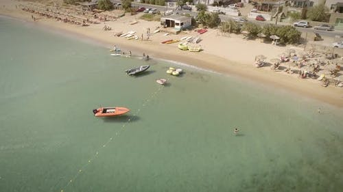 Aerial view of a small water sports center on a beach in Greece.