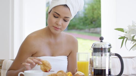 Thumbnail for Woman In Towel Dipping Donut In Coffee