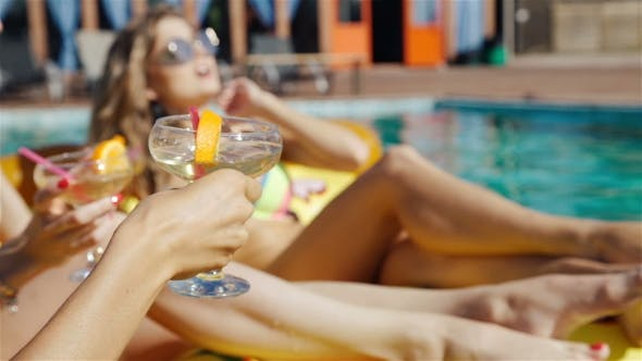 Thumbnail for Friends Enjoying Drinks At The Pool
