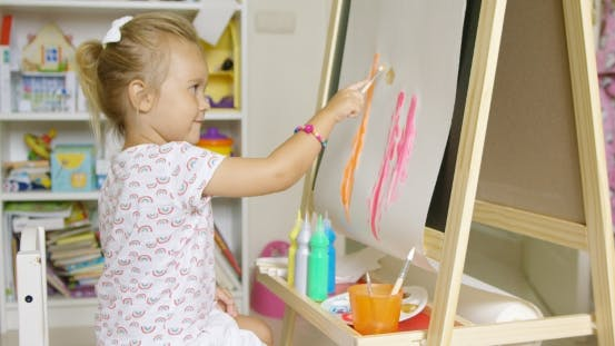 Thumbnail for Cute Little Blond Girl Painting With Watercolors