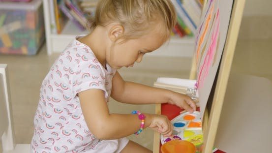 Thumbnail for Cute Little Girl Mixing Paints For Her Painting