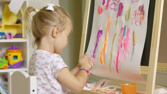 Thumbnail for Creative Little Girl Painting An Abstract Picture